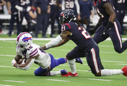 Bills receiver John Brown dives forward for extra yards against the Texans Bradley Roby.
