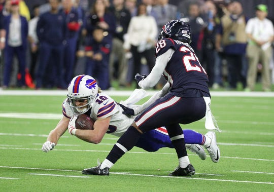 Bills receiver Cole Beasley dives for extra yards against the Texans.