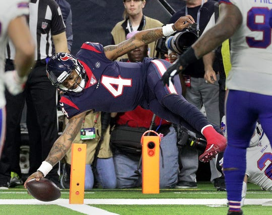 Houston quarterback Deshaun Watson dives for the corner of the end zone to score on this two-point conversion.  The Texans beat the Bills 22-19 in overtime.