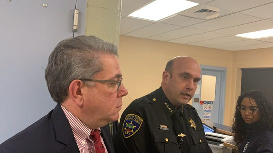 Ontario County Sheriff Kevin Henderson, center, is flanked by District Attorney Jim Ritts, left.