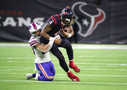 Texans quarterback Deshaun Watson is caught from behind by Bills Micah Hyde.