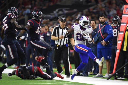 Buffalo Bills running back Devin Singletary (26) is forced out of bounds by Houston Texans' Benardrick McKinney (55), Zach Cunningham (41) and Mike Adams (27) during the second half of an NFL wild-card playoff football game Saturday, Jan. 4, 2020, in Houston. (AP Photo/Eric Christian Smith)