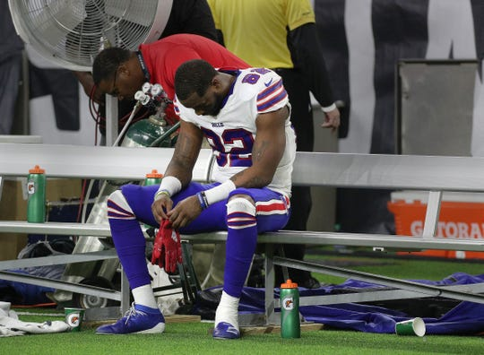 Bills receiver Duke Williams sits alone on the bench after Buffalo lost to the Texans 22-19 in overtime in the wildcard game.