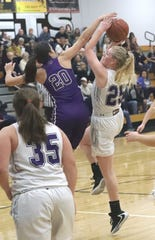 Redding Christian forward Sammie Wunner tries to make a basket against Willows defender Meghan Weinrich in the title game of the Lady Hornet Classic at Enterprise High School on Saturday, Jan. 4, 2020. Redding Christian lost to Willows 52-46.