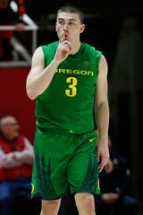 Oregon guard Payton Pritchard (3) silences the crowd after a 3-pointer against Utah in the second half during an NCAA college basketball game Saturday, Jan. 4, 2020, in Salt Lake City.