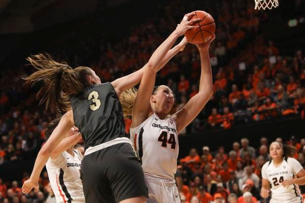 Colorado's Emma Clarke (3) and Oregon State's Taylor Jones (44) fight for possession of a rebound during the first half of an NCAA college basketball game in Corvallis, Ore., Sunday, Jan. 5, 2020. (AP Photo/Amanda Loman)