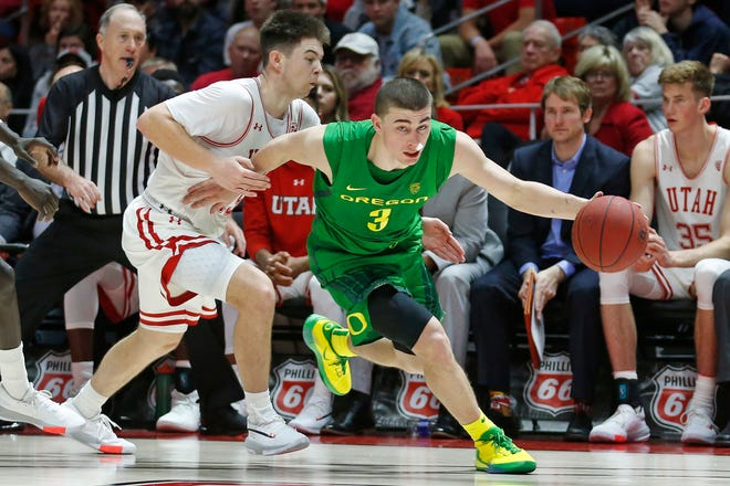 Oregon guard Payton Pritchard (3) drives around Utah guard Rylan Jones, left, in the second half during an NCAA college basketball game Saturday, Jan. 4, 2020, in Salt Lake City.