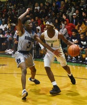 Bossier High's Otis Smith (1) drives the ball during the championship game of the 80th Bossier Bearkat Tournament in January.