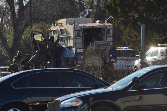 Special Response Team members are on the scene where at least one person is barricaded in a residence.