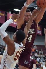 Missouri State center Gaige Prim attempts a pass through a Loyola defender at Gentile Arena in Chicago.