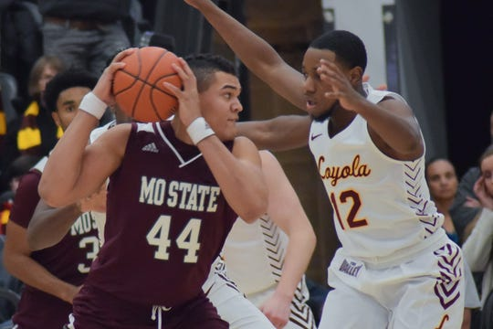 Missouri State center Gaige Prim battles down low during a matchup against Loyola at Gentile Arena in Chicago on Jan. 4, 2020.
