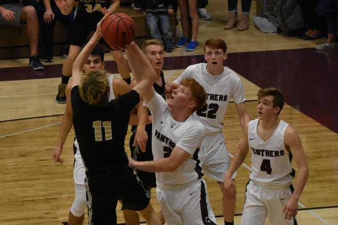 Desert Hills' Mason Chase (11) fires a shot over Pine View's Jared Sudweeks during the Panthers' win over the Thunder earlier this year.
