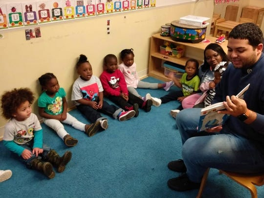 Each month, when the books arrive for the children, Tallahassee Kiwanians and their CKI students will go to the Budd Bell Center and read the new books to the children!.