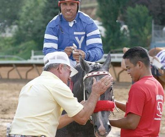 Trainer Fred Danley, left, is one of  the top horse trainers in New Mexico and has been training since he was a teenager.