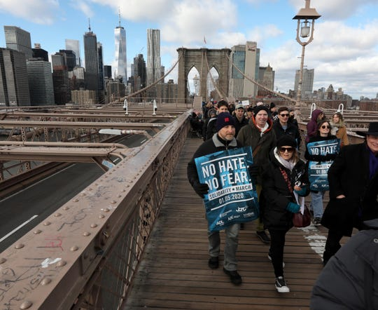 "Greg and Evan Karzhevsky of Blauvelt, N.Y. were among the thousands that marched from Manhattan to Brooklyn across the Brooklyn Bridge Jan. 5, 2020 during the ""No Hate, No Fear Solidarity March"" in New York City Sunday. The rally comes after last weekend's stabbing attack at a Hanukkah celebration in Monsey, New York."