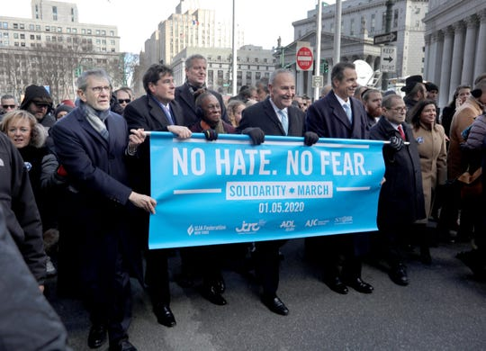 "Elected officials including New York Governor Andrew Cuomo, New York City Mayor Bill De Blasio, Senator Charles Schumer, and Rep. Jerrold Nadler led thousands who marched from Manhattan to Brooklyn across the Brooklyn Bridge Jan. 5, 2020 during the ""No Hate, No Fear Solidarity March"" in New York City Sunday. The rally comes after last weekend's stabbing attack at a Hanukkah celebration in Monsey, New York."