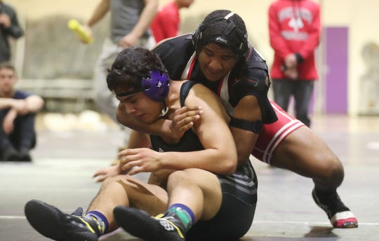 North Rockland's Emmanuel Mena on his way to defeating New Rochelle's Sebastian Lujan wrestle in the 220-pound weight class during the Shoreline Wrestling Tournament championship at New Rochelle High School Jan. 4, 2020.