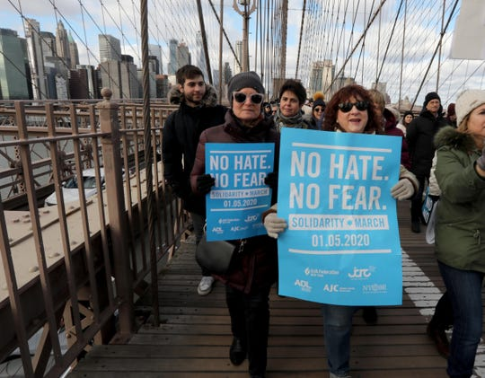 "Sabra Waxman and Fran Silverman from Temple Sinai in Tenafly, New Jersey were among the thousands that marched from Manhattan to Brooklyn across the Brooklyn Bridge Jan. 5, 2020 during the ""No Hate, No Fear Solidarity March"" in New York City Sunday. The rally comes after last weekend's stabbing attack at a Hanukkah celebration in Monsey, New York."