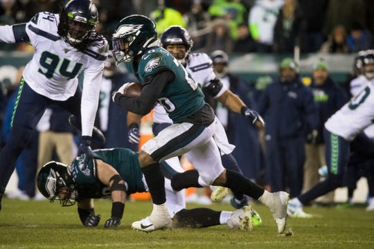 Eagles' Miles Sanders (26) rushes downfield Sunday against the Seahawks.