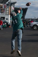 Eagles fans tailgate before Philadelphia's NFC Wild Card matchup against the Seattle Seahawks Sunday outside of Lincoln Financial Field.