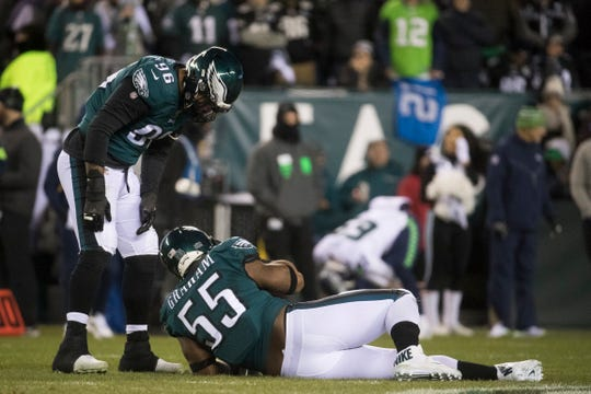 Eagles' Brandon Graham (55) goes down with an injury during the first half against the Seahawks Sunday at Lincoln Financial Field.