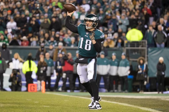 Eagles' Josh McCown (18) throws downfield Sunday against the Seahawks.
