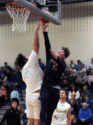 Gabe Altier goes in for a layup over Maysville's Ethyn McClelland during the Raiders' 68-62 win on Saturday in Newton Township.