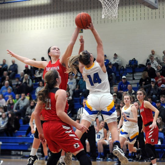 Sheridan's Faith Stinson blocks the shot of Maysville's Bailee Smith during the Generals' 51-43 win on Saturday in Newton Township.