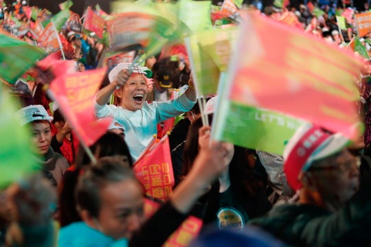 Supporters of Taiwanese President Tsai Ing-wen cheer during an election campaign event in New Taipei City, Taiwan.