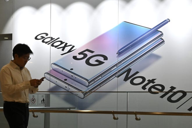 A man walks past an advertisement for the Samsung Galaxy Note10 smartphone at its showroom in Seoul on Oct. 31, 2019.
