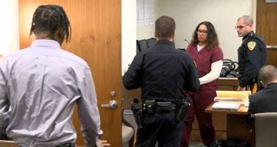 Jada McClain, 18, leaves State Superior Court in Freehold, Monday, January 6, 2020, after pleading guilty to aggravated manslaughter for the death of her baby.   The baby's father Quaimere Mohammed, 19, enters the court to plead guilty to desecration of human remains for tossing the infant's remains in a dumpster.