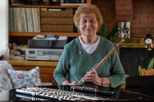 Marjorie Koharski, a longtime professional flutist who provides private flute lessons to people of all ages and skill levels and also performs with several musical trios and duos, plays in her home in Neptune, NJ Monday, January 6, 2020.