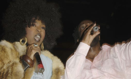 Ms. Lauryn Hill and Wyclef Jean reunite with Pras Michel of The Fugees at the Verizon Wireless Outdoor Concert on Feb. 6, 2006 in Hollywood, California.