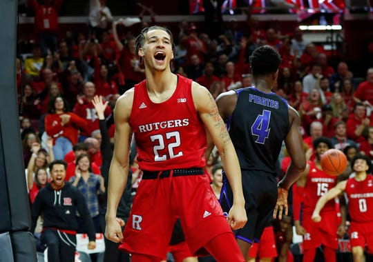 Rutgers Scarlet Knights guard Caleb McConnell (22) is in the spotlight after taking over for injured point guard Geo Baker.