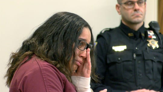 Jada McClain, 18, wipes away tears Monday, January 6, 2020, in State Superior Court in Freehold, as she pleads guilty to aggravated manslaughter for pressing down on her newborn's chest until he stopped breathing.  She faces a 10-year prison term.