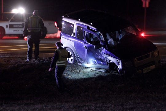 Brick Township police are shown at the scene of a two car accident on Route 70 westbound at Van Zile Road Sunday night.