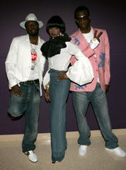 Wyclef Jean, Lauryn Hill and Pras Michel of the Fugees pose backstage at the BET Awards 05 at the Kodak Theatre on June 28, 2005 in Hollywood, California.