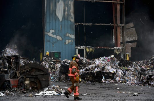 Lt. Jarvis  Henderson of the Apalachin Fire Department at Taylor Garbage's recycling plant in Apalachin on Monday morning following a fire which broke out on Friday evening. Monday, January 6, 2019.
