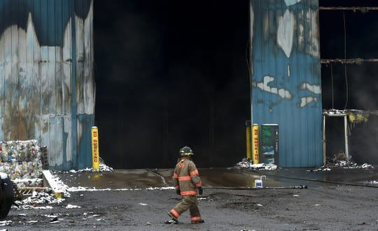 Firefighters continue to battle smoldering waste at Taylor Garbage's recycling plant in Apalachin on Monday morning following a fire which broke out on Friday evening. Monday, January 6, 2019.
