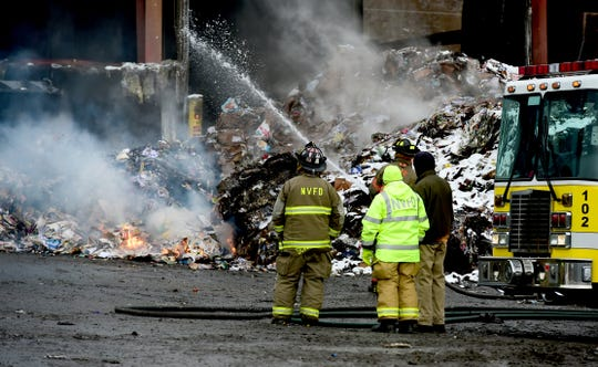 Firefighters continue to battle hot spots at Taylor Garbage's recycling plant in Apalachin on Jan. 6, 2020 following a fire that broke out on Jan. 3.