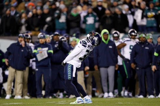 Seattle Seahawks' Bradley McDougald celebrates after tackling Philadelphia Eagles' Boston Scott during the second half of an NFL wild-card playoff football game, Sunday, Jan. 5, 2020, in Philadelphia.