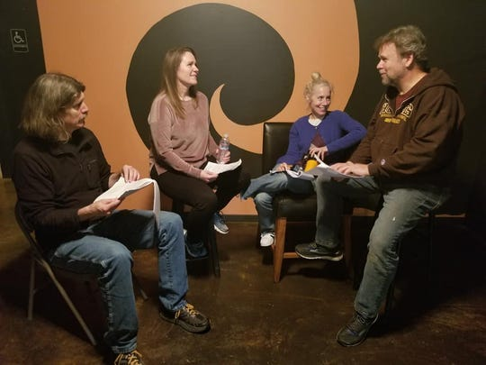 Director Wilson Milam (from left) talks script with cast members Michelle Allen, Helen Heaslip and Wayne Purves.