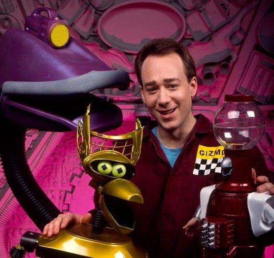 """Joel Hodgson, with sidekicks (from left) Gypsy, Crow and Tom Servo, in """"MST3000's"""" early days."""
