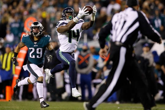 Seattle Seahawks' D.K. Metcalf (14) catches a touchdown pass as Philadelphia Eagles' Avonte Maddox (29) trails during the second half of an NFL wild-card playoff football game, Sunday, Jan. 5, 2020, in Philadelphia.