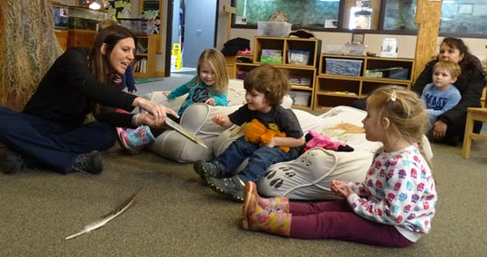 """Lisa Bogard reads """"Nice Catch"""" to preschoolers during Nature Story Time on Monday morning at Lowe-Volk Nature Center. From left are Bogard, Maddie Bauer, 3; Landen Higgins, 3; Zelie Matzger, 3; Kameron Cochran, 4; and his mom, Tiffany Cochran."""