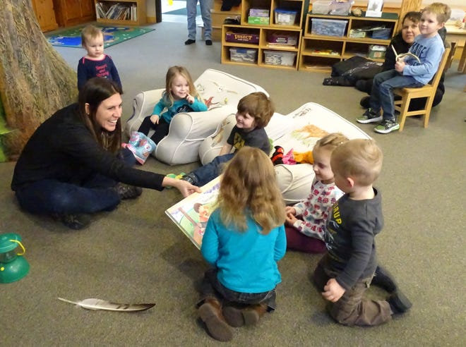 """Lisa Bogard reads """"Nice Catch"""" to preschoolers during Nature Story Time on Monday morning at Lowe-Volk Nature Center."""