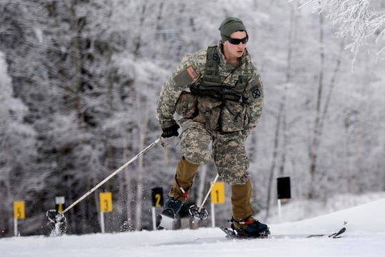 U.S. Army Spc. Troy Anger, infantryman, Alpha Company, 3rd Battalion, 172nd Infantry Regiment, 86th Infantry Brigade Combat Team (Mountain), Vermont National Guard, skis at Camp Ethan Allen Training Site, Jericho, Vt., January 25, 2017. Soldiers from both the Vermont and Colorado National Guard participated in a stress-shoot training, which incorporated squads skiing, shooting and communicating together in mountainous terrain. (U.S. Air National Guard photo by Tech. Sgt. Sarah Mattison)