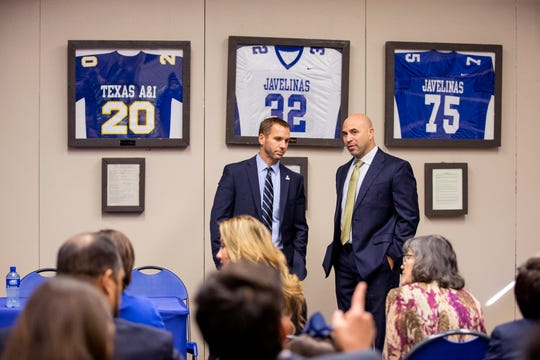 Texas A&M University-Kingsville Executive Director of Athletics and Campus Recreation Steve Roach, left, talks with new Javelina head coach Mike Salinas prior to a a press conference introducing Salinas on Monday, January 6, 2019.