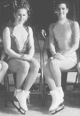 Figure skaters Tonya Harding, left, and Nancy Kerrigan pose Jan. 9, 1994, during U.S. figure skating championships at Joe Louis Arena in Detroit.