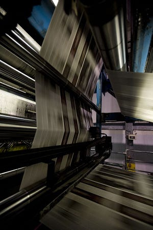 Newspapers on the press.